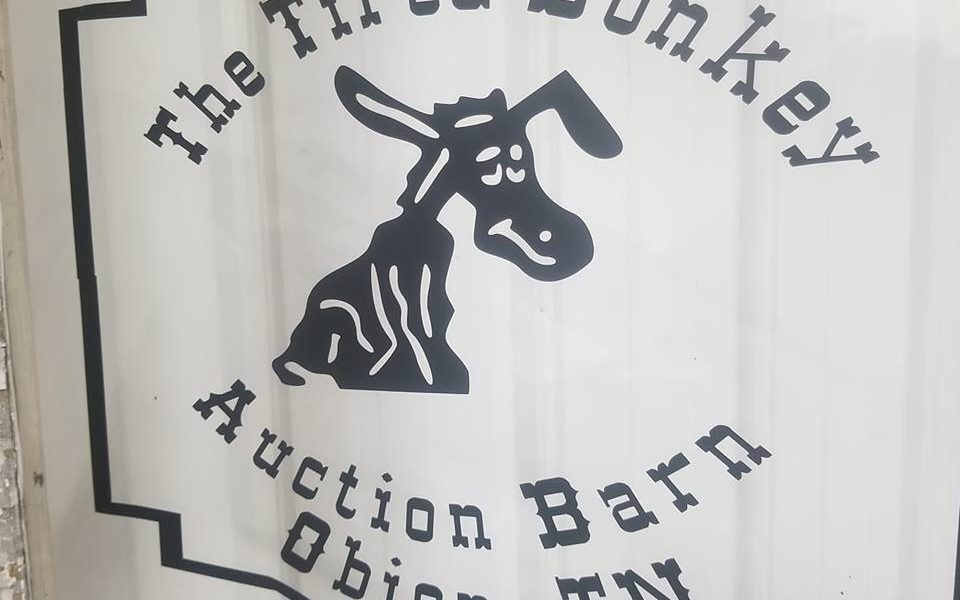 The Tired Donkey Auction Barn